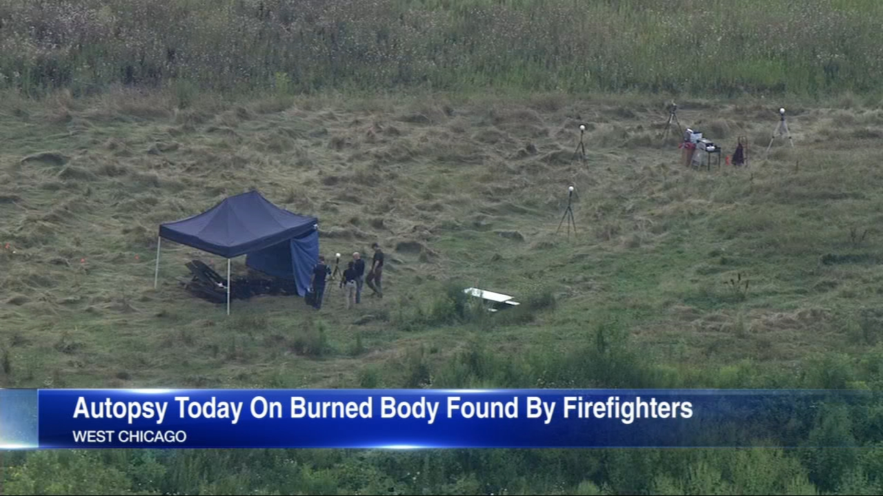 An autopsy will be performed Wednesday on the burned body of a man found in a field by firefighters in DuPage County.