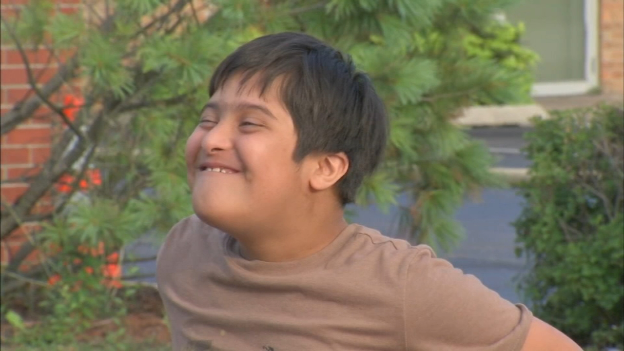 An 11-year-old boy with Down syndrome was inside a vehicle that was towed while his father delivered a pizza to a mosque is west suburban Glendale Heights Friday afternoon, police