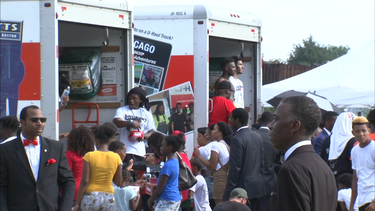 An event organized by rapper Vic Mensa distributed 10,000 pairs of shoes and gave free haircuts Sunday in Chicago's South Side Englewood community.