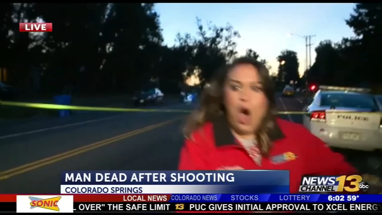 Terrifying video shows a driver plowing into the crime scene as a reporter was live on the air.