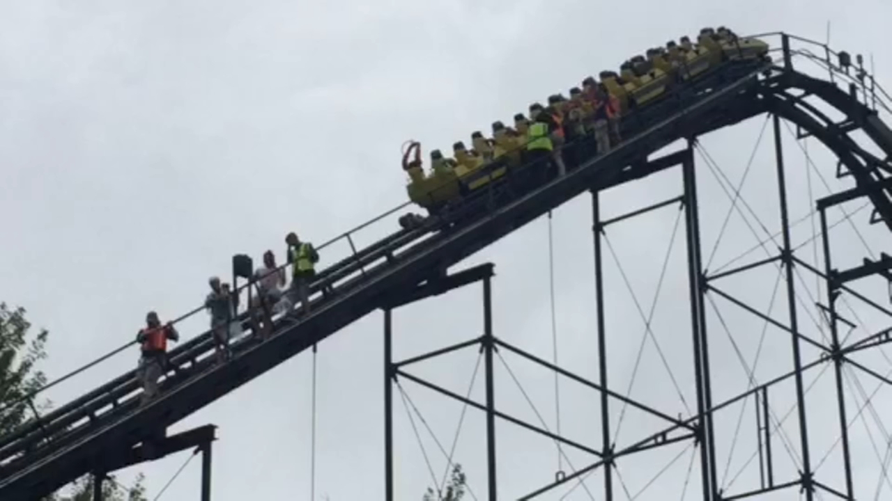 Passengers on a Six Flags roller coaster were stuck briefly and then escorted off due to a safety sensor malfunction.