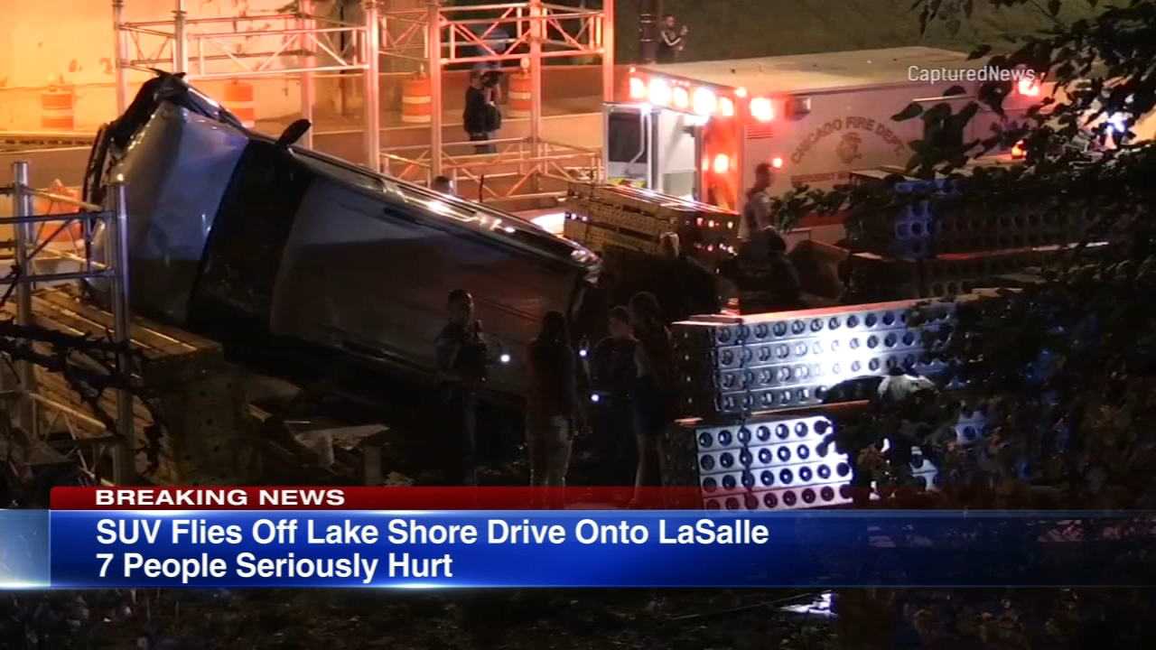 Seven people were injured after an SUV flew off the road on Lake Shore Drive and onto construction equipment on the North Side Tuesday morning, authorities said.