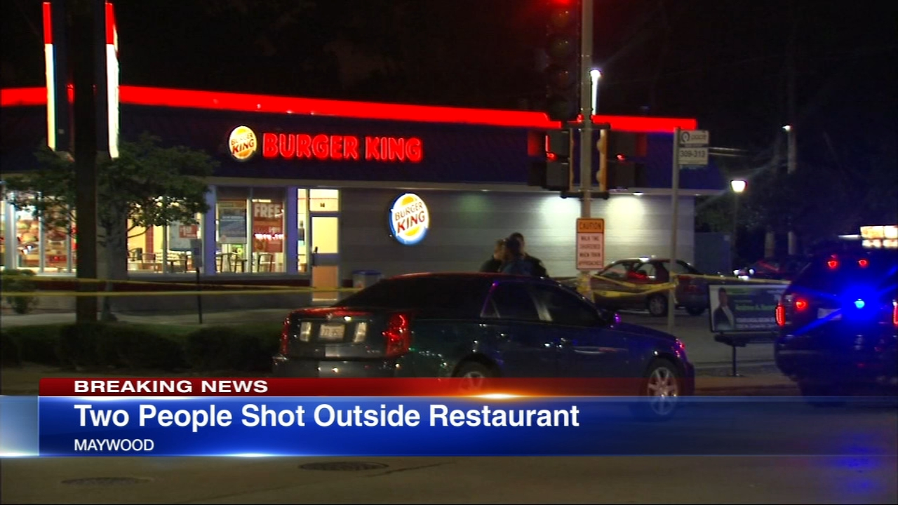 Witnesses said that a police officer and Burger King employee were shot Sunday night in west suburban Maywood.