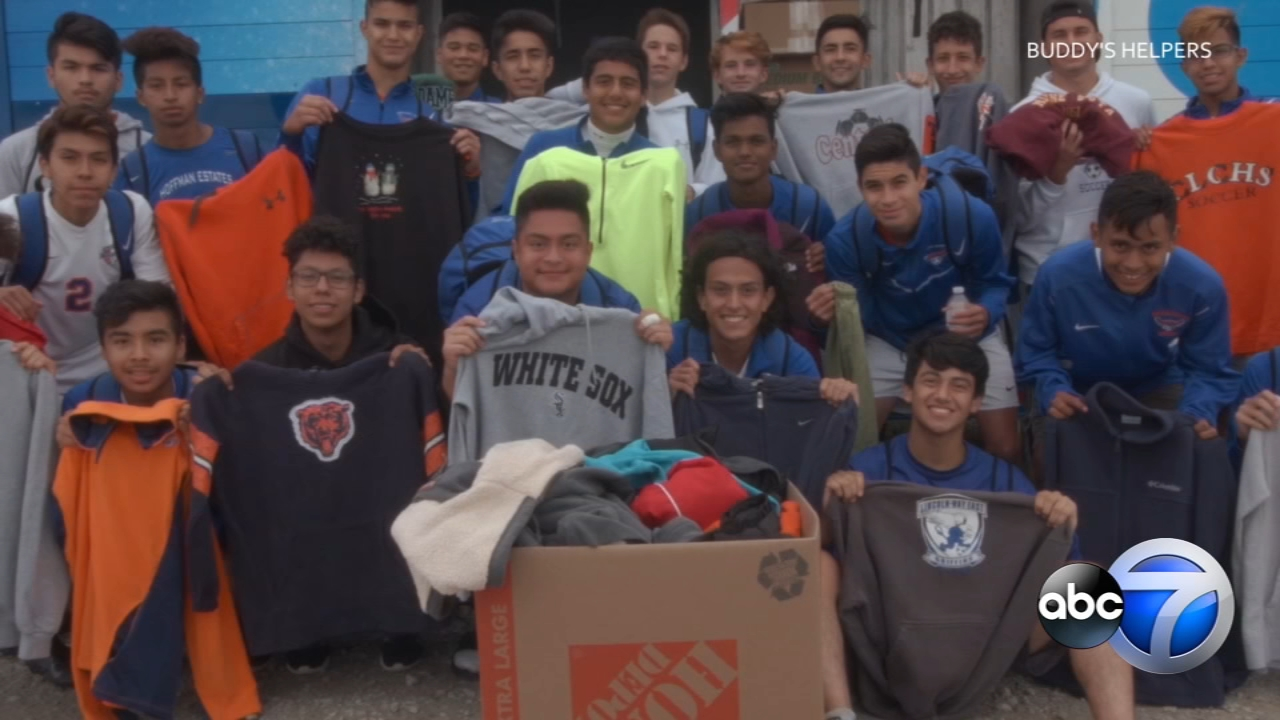 Students helped load the sweatshirts they collected into a truck at the PepsiCo Showdown soccer tournament in Joliet.