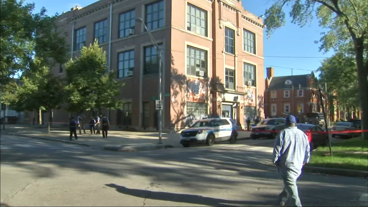 Two people are in custody after two teenagers and a man were shot near a Chicago charter school Monday.