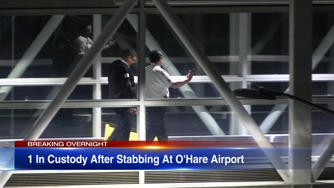 A man was stabbed on a walkway bridge at OHare Airport Wednesday morning and another man is in custody, Chicago police said.