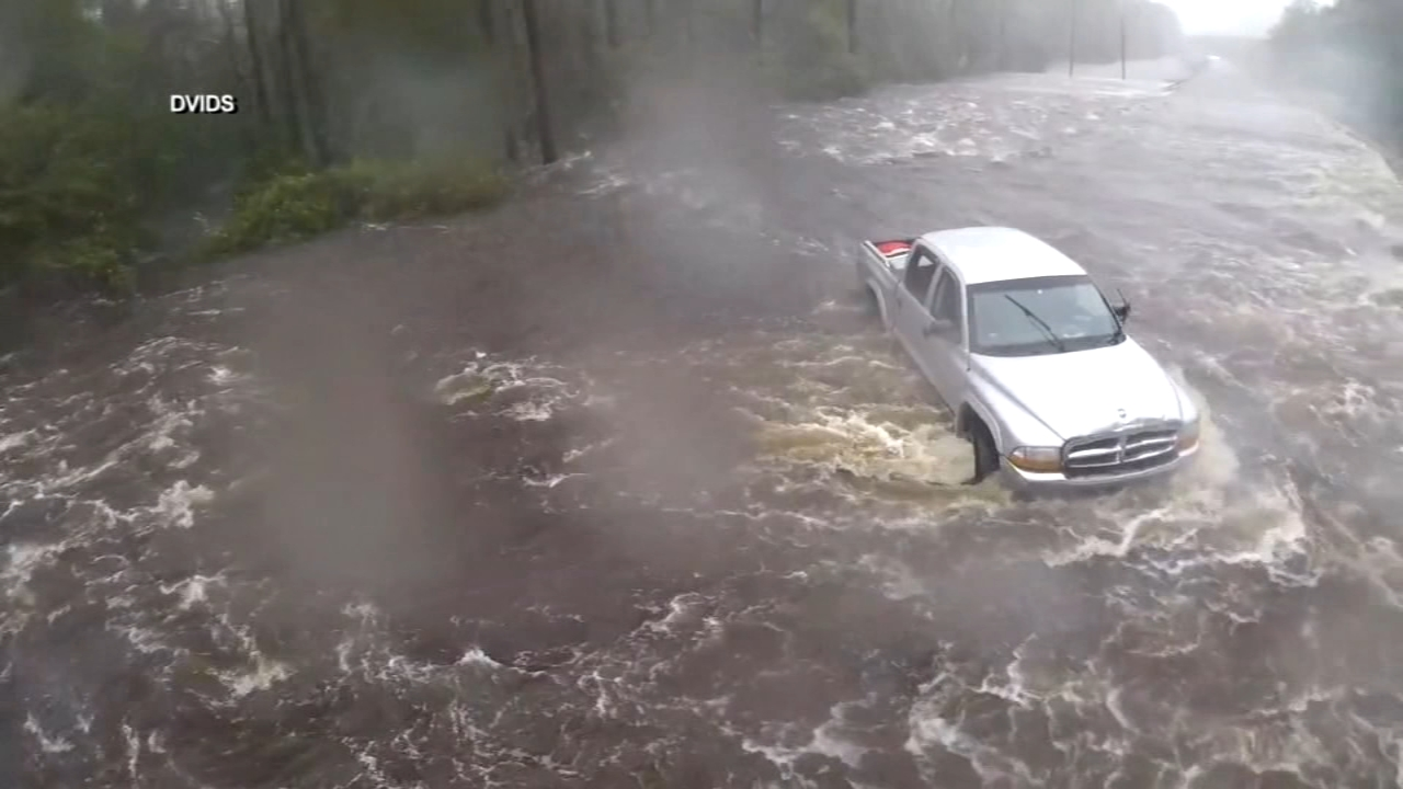 Residents grapple with flooding after Florence moves through Carolinas.