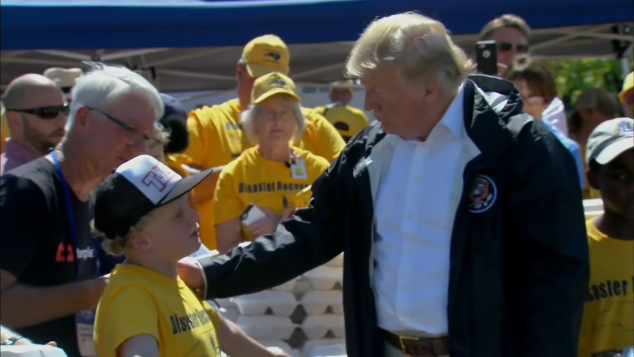 Eager to show heart in a moment of crisis, President Donald Trump handed out hot dogs, hugs and comforting words in the Carolinas on Wednesday as he surveyed the wreckage left by H
