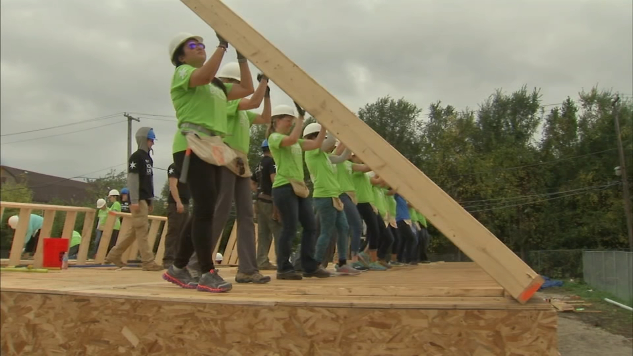 Women worked together on Chicagos Far South Side Wednesday to build a handful of houses from the ground up, which will become homes to city families led by women.