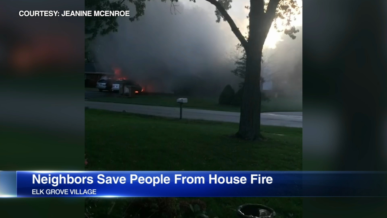 Four people escaped a burning house thanks to the heroic efforts of their neighbors.