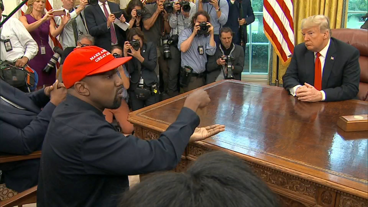 WARNING: GRAPHIC LANGUAGE - Declaring that his red MAGA hat makes him feel like Superman, Chicago-born rapper Kanye West made a free-styling appearance in the Oval Office Thursday.