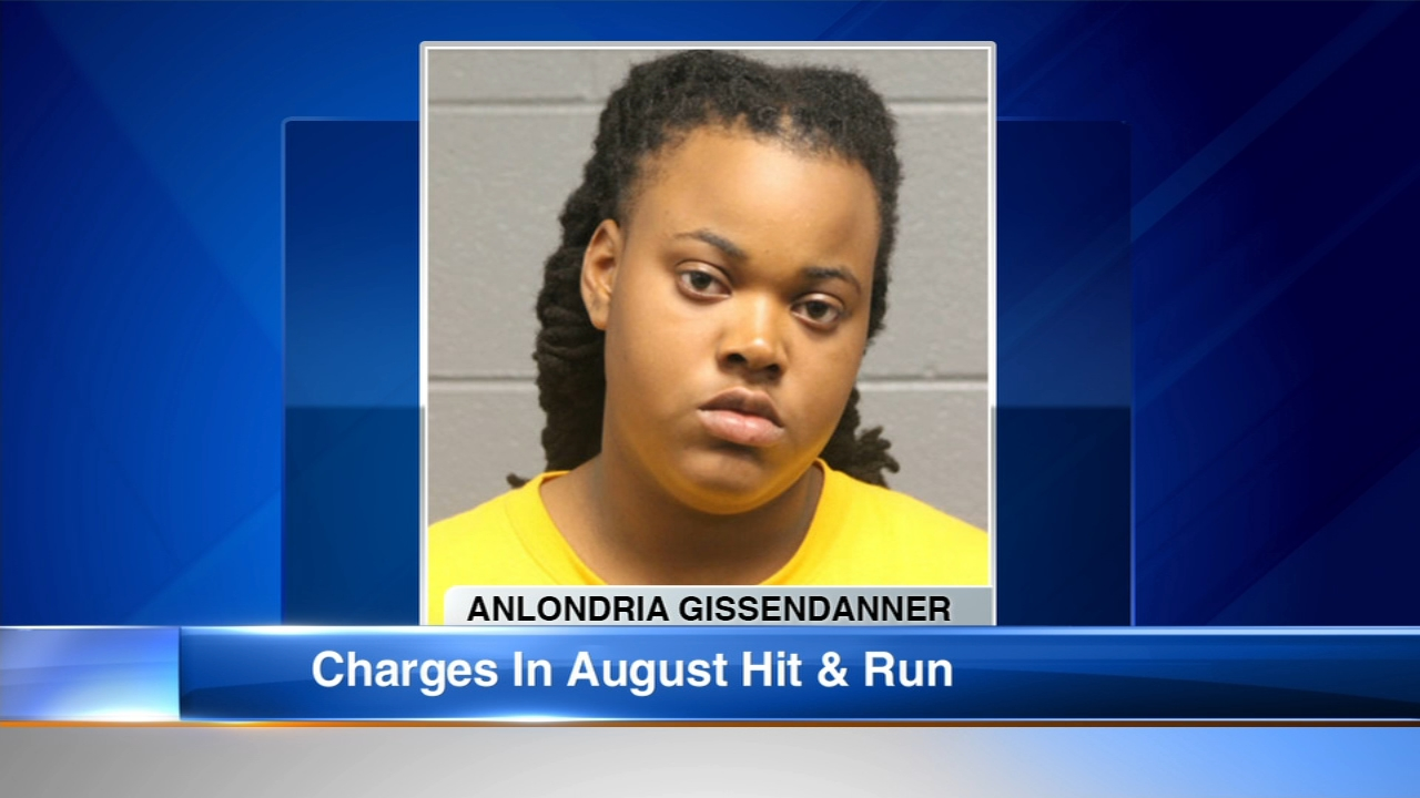 A South Side woman has been charged in a hit-and-run crash that left two people hurt back in August.
