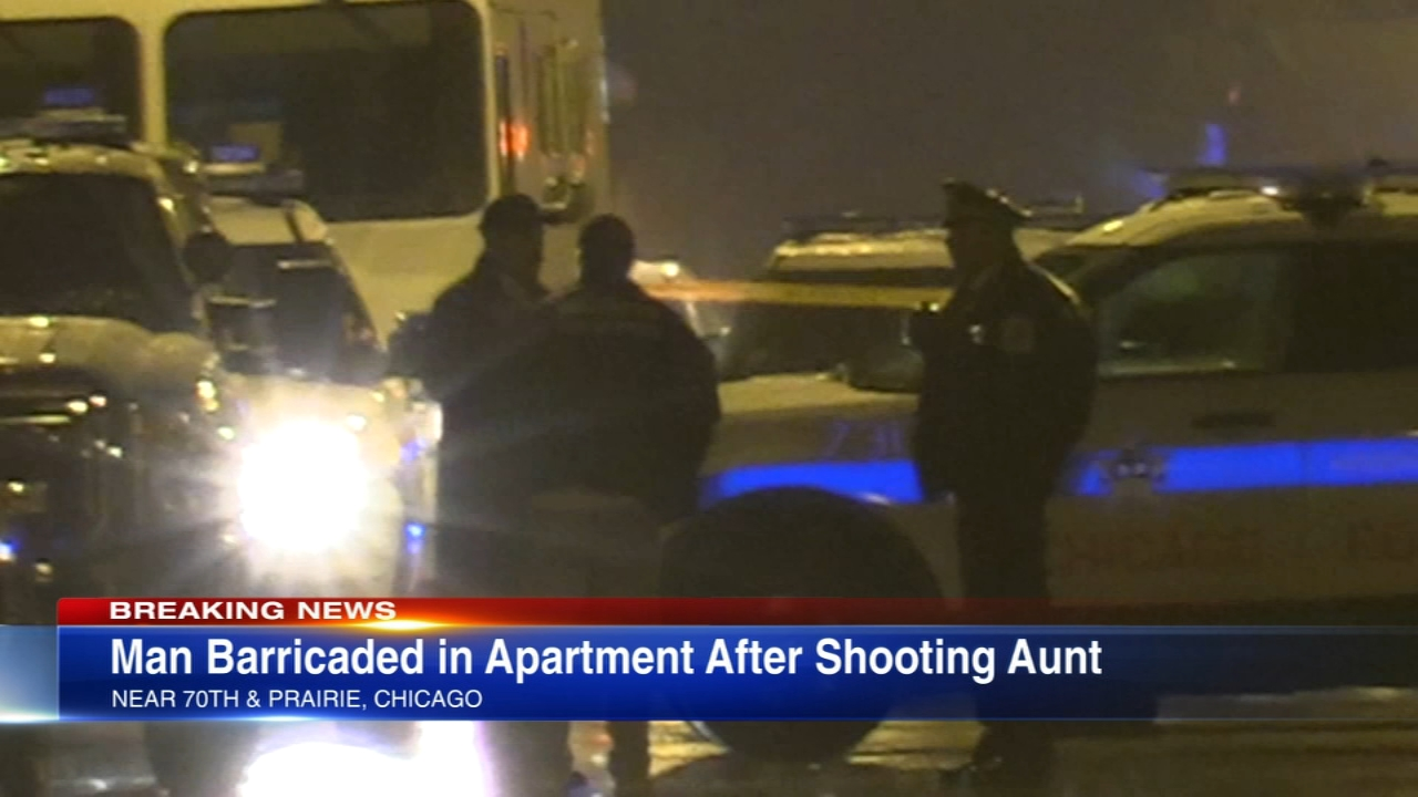 Chicago police have surrounded a home in the Park Manor neighborhood after a 39-year-old woman was shot Monday morning.