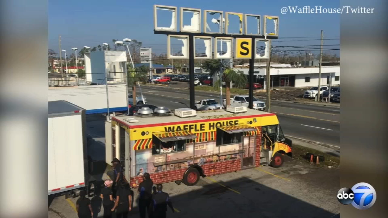 Waffle House employees handed out free food from a food truck parked underneath a storm-battered sign in Panama City, Florida.