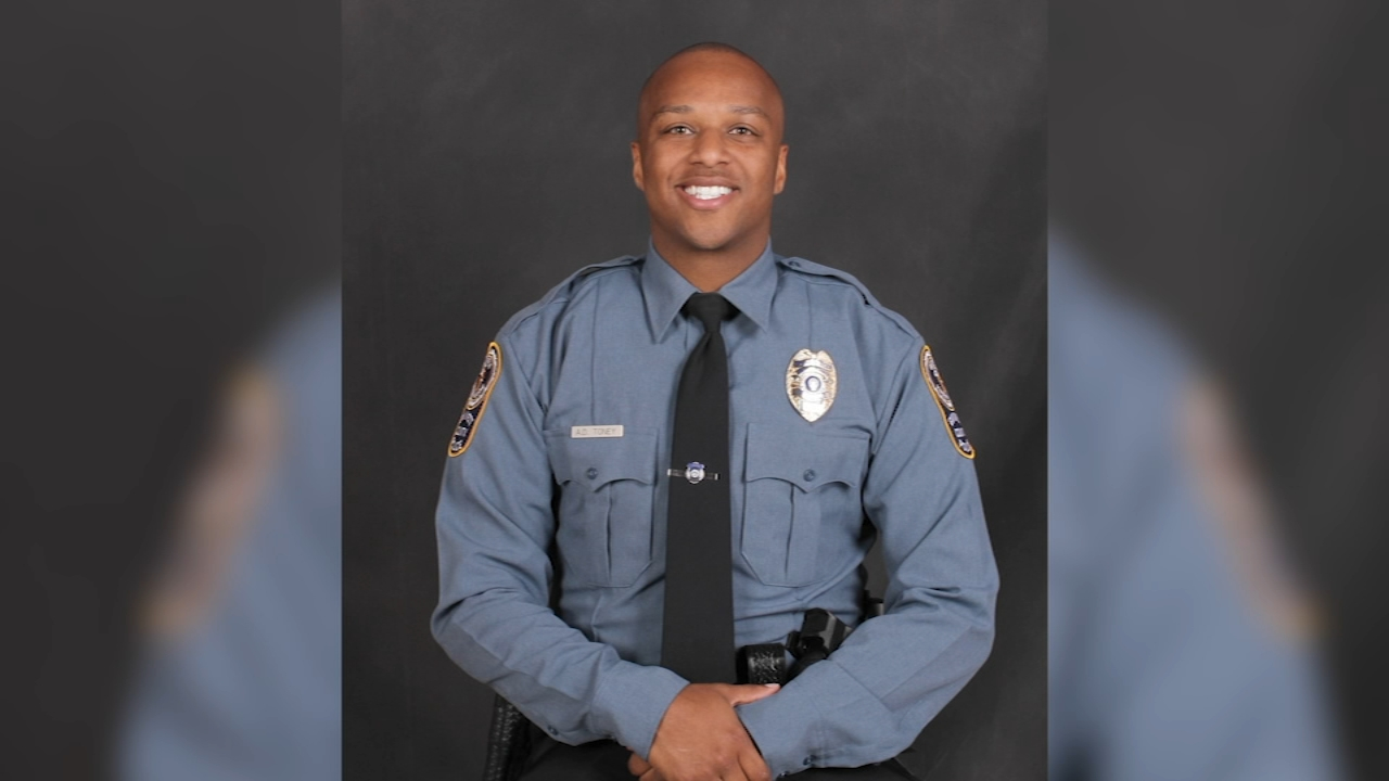 Police in Georgia are searching for a man suspected of killing a police officer who was answering a call about a suspicious vehicle near a middle school, authorities said.