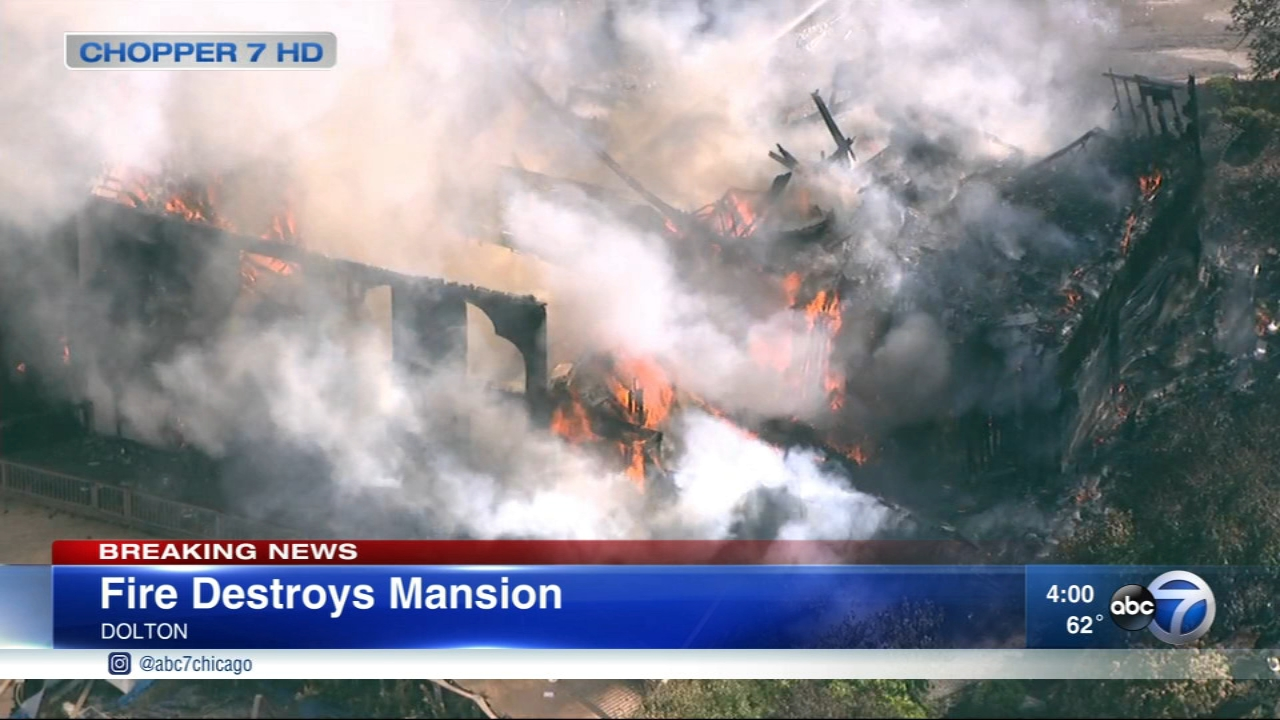 Police are investigating a massive fire that destroyed a home in south suburban Dolton previously owned by NBA player Dwayne Wade as a possible arson.