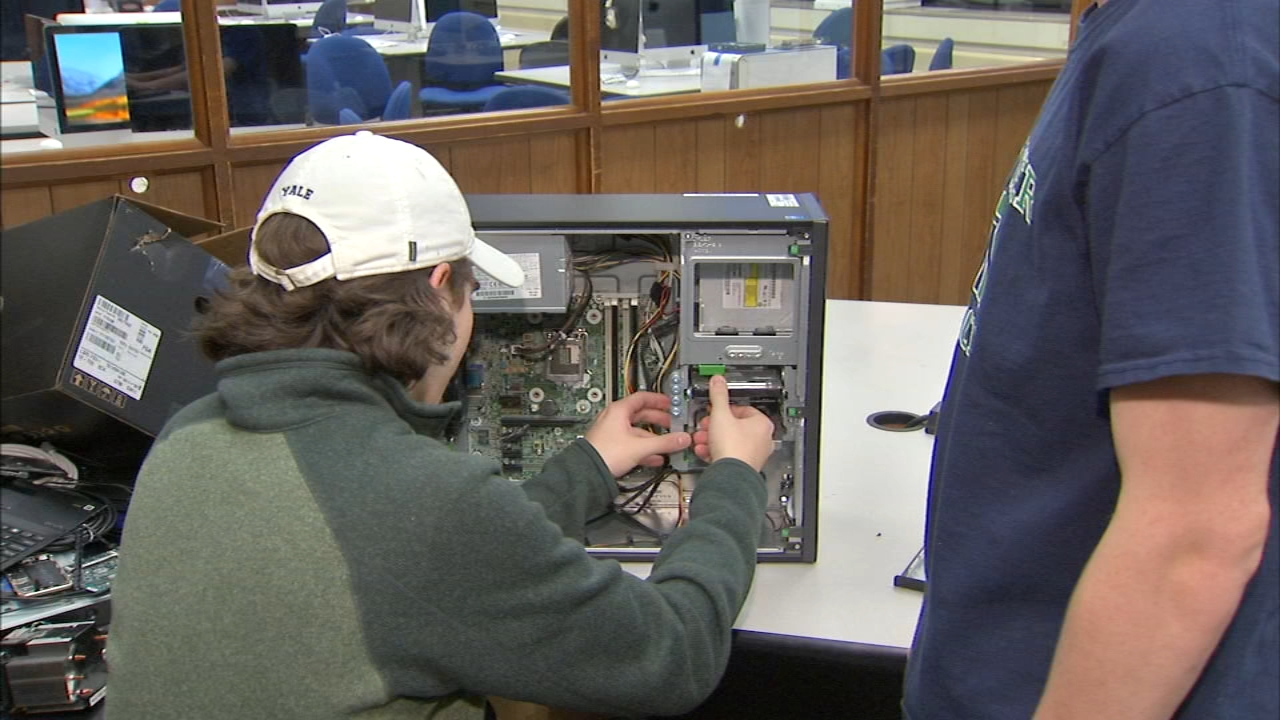 Students in the Binary Heart after school club at New Trier High School are making what is old new again by refurbishing computers.