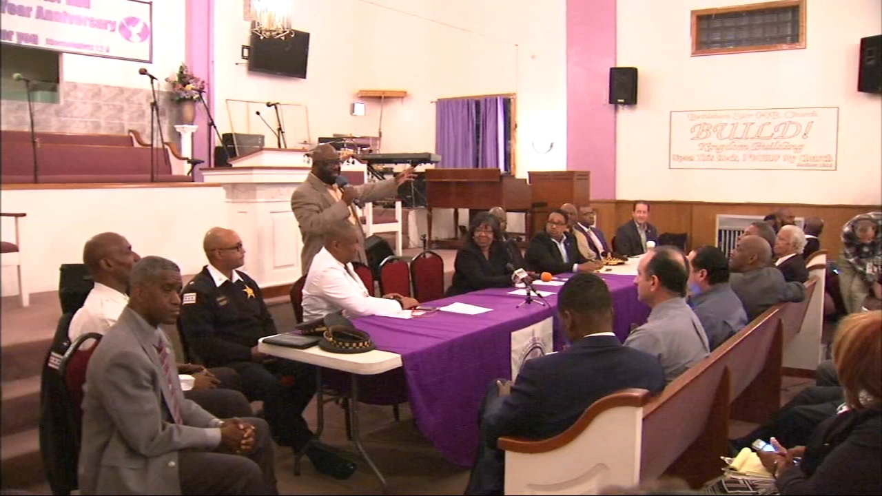 A community is fighting back after a shooting outside a church during a funeral injured six people.