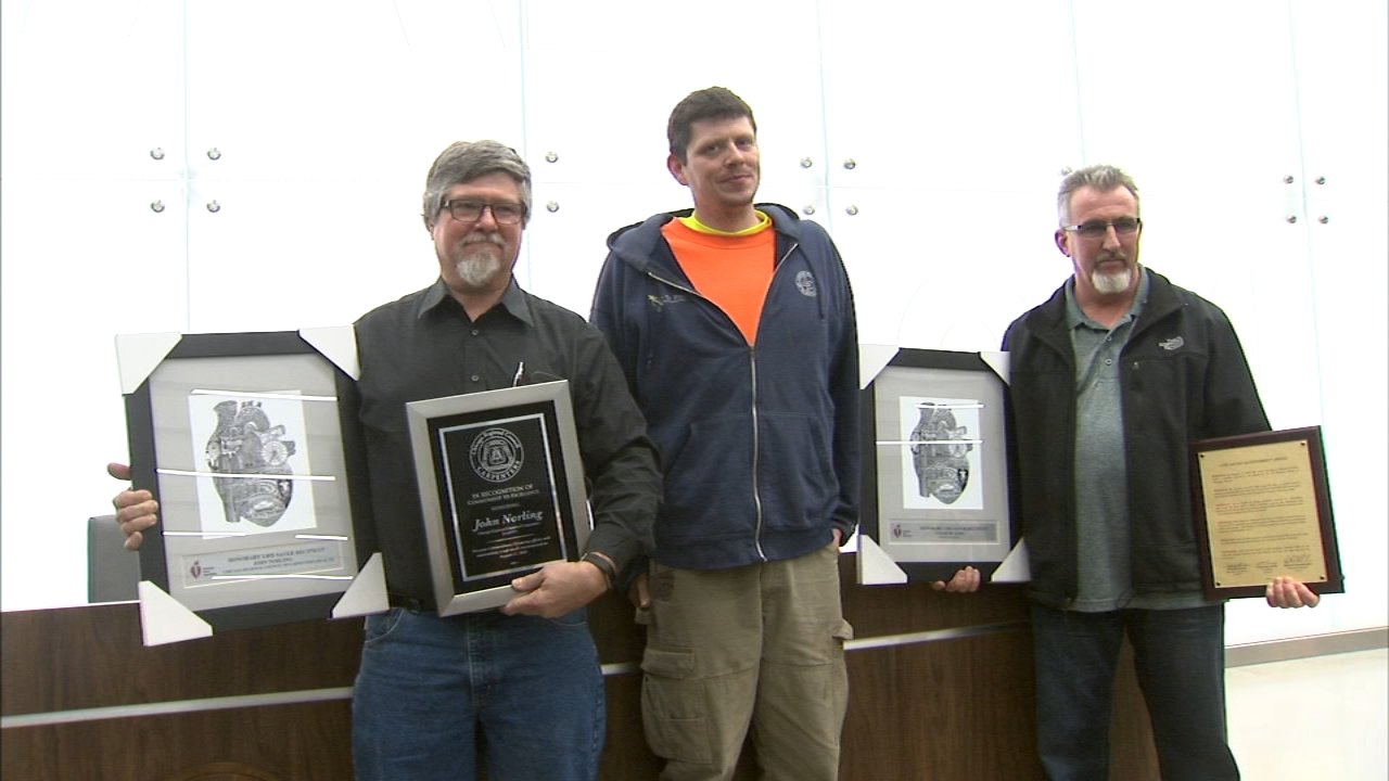 Two employees of the Lyons Pinner Electric Company were honored Wednesday for saving a coworker's life earlier this year.