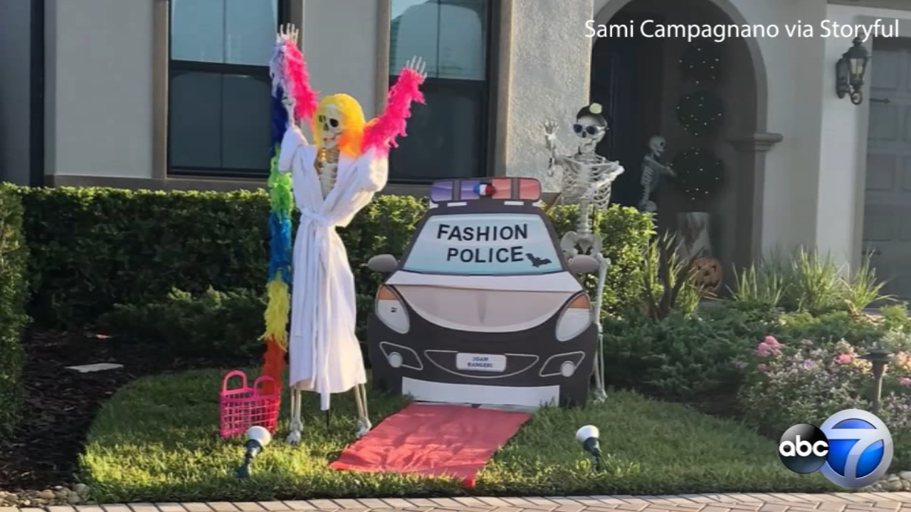 A Halloween display in Florida is going viral after a college student began tweeting daily updates on her neighbors changing decorations.