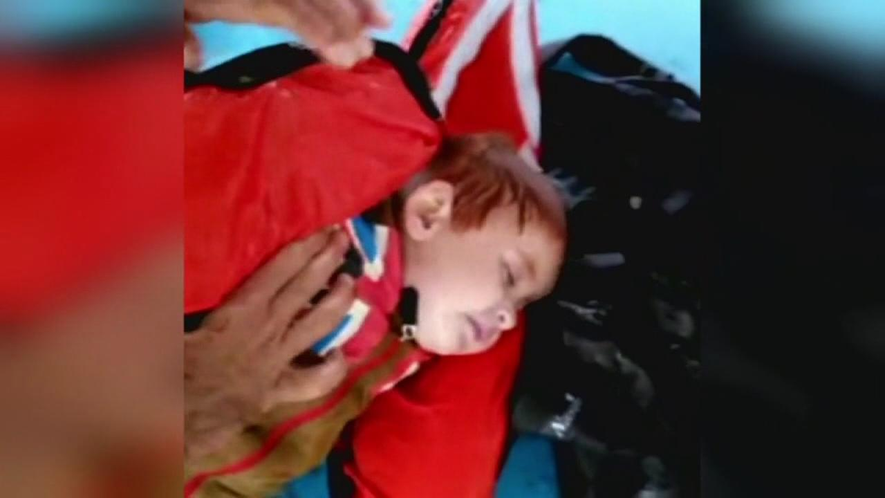Baby rescued after migrant boat capsizes