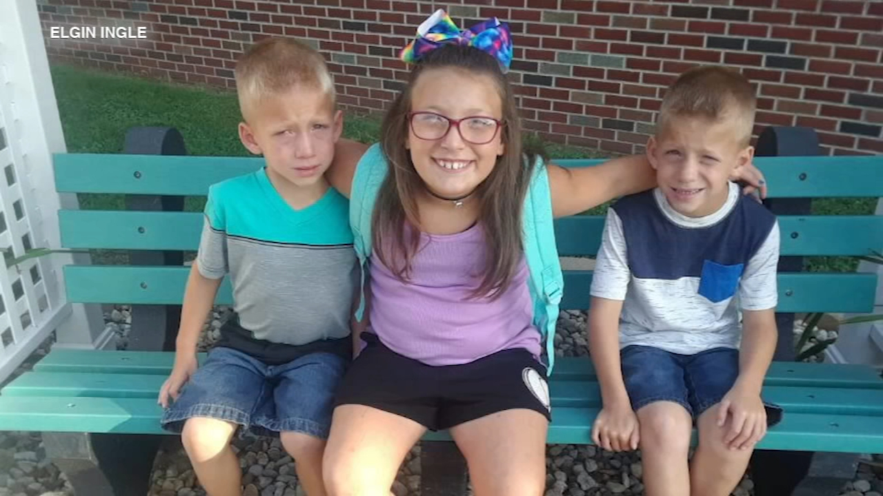 A church service is underway to remember three siblings who were struck and killed Tuesday morning as they crossed the street to their school bus in Rochester, Indiana.