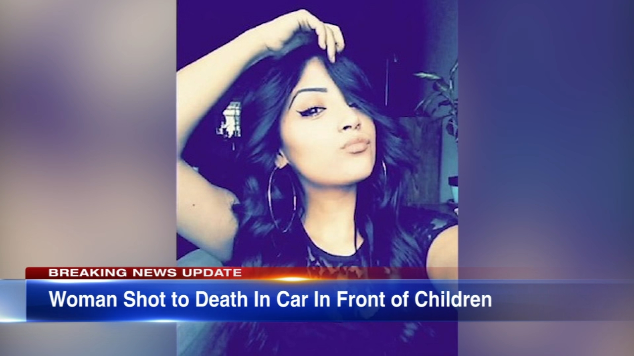 A 21-year-old woman was shot and killed in front of her two nieces after a robber got into her car on Chicagos Northwest Side Wednesday night, police said.