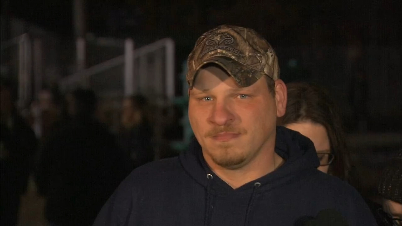 The father of one of the three siblings struck and killed while trying to board their school bus attended a vigil near Rochester, Indiana, Friday night.