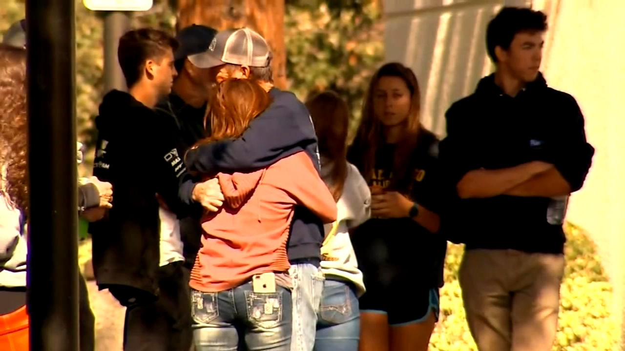 Families and friends are overcome by grief after 12 people were killed in in a bar shooting in Thousand Oaks, California.