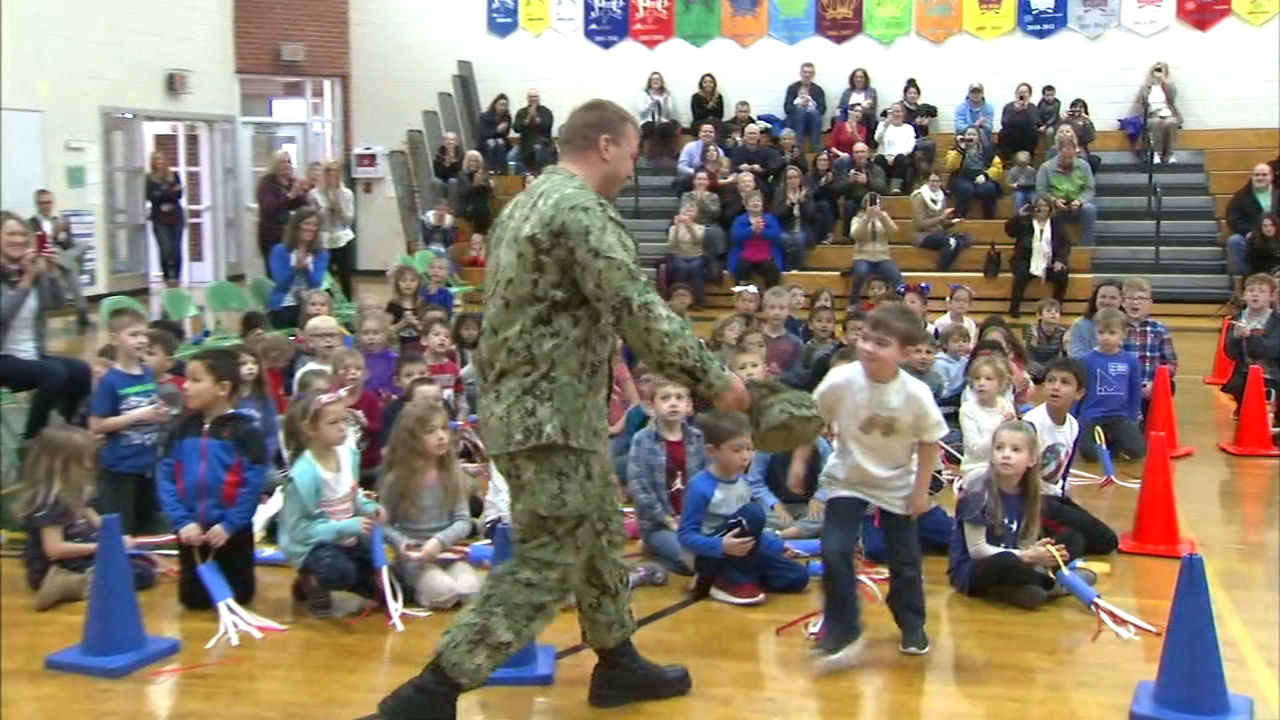 A north suburban soldier surprised his 6-year-old son at school Monday morning as he returned home from active duty.