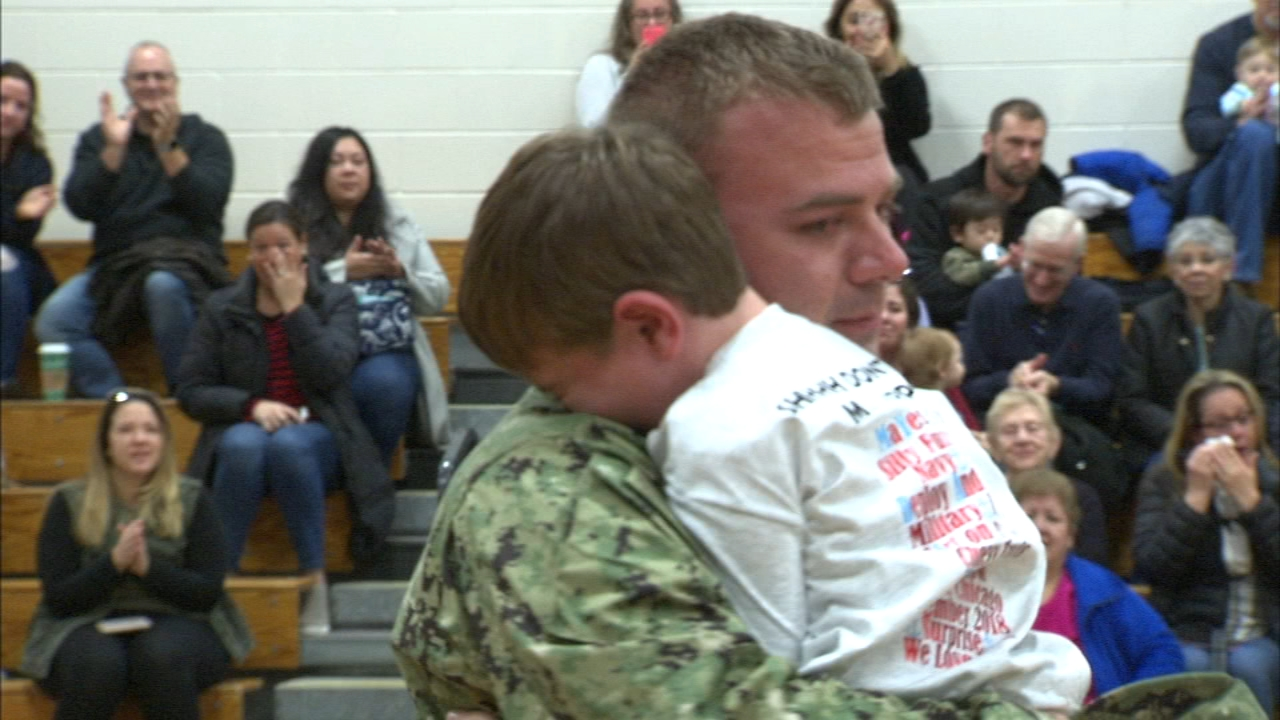 A north suburban seaman surprised his son at school Monday morning as he returned home from active duty.