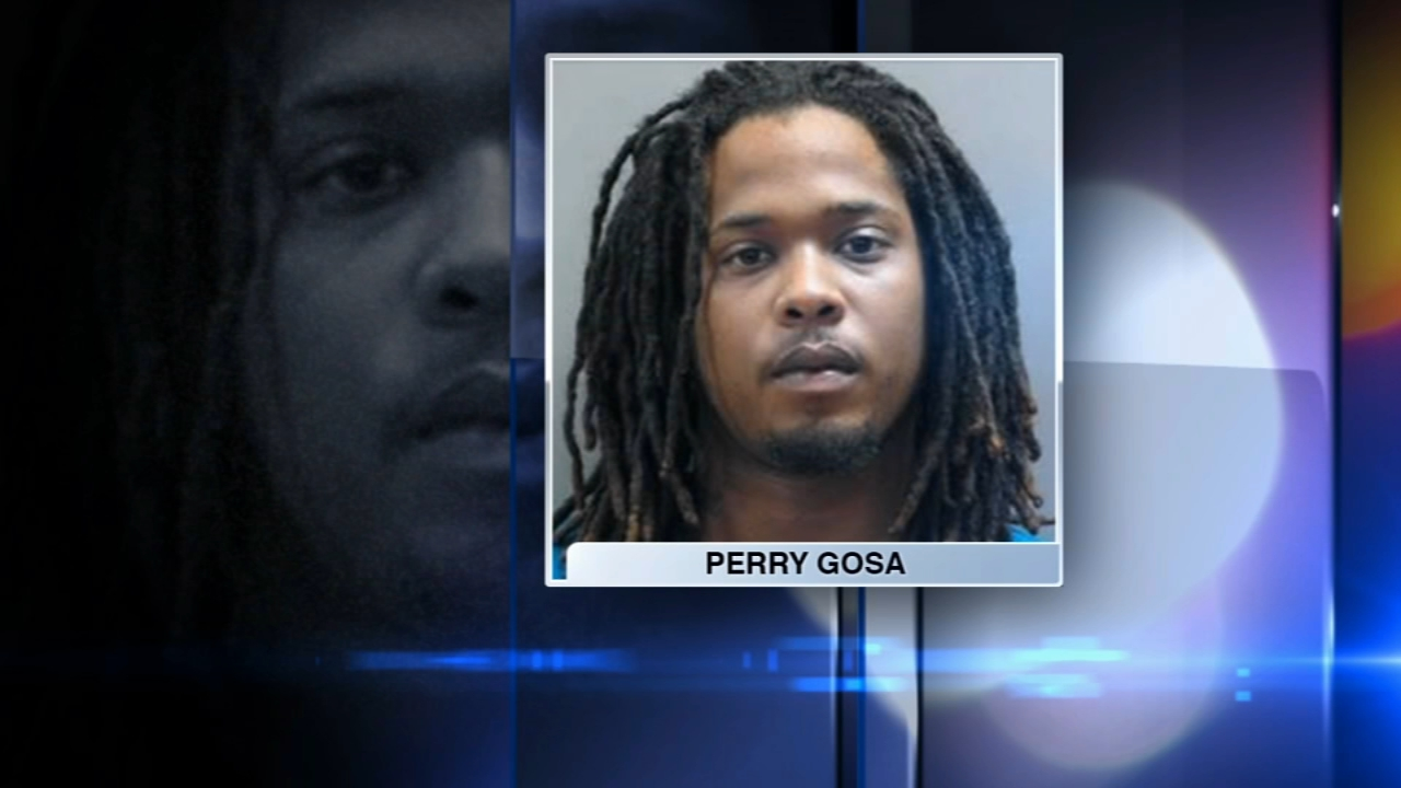 A Matteson man accused of killing a barber in Harvey has turned himself in, police said Tuesday.