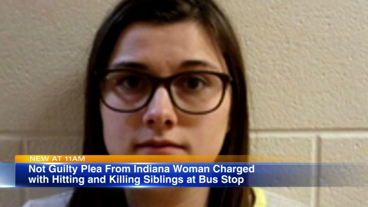 An Indiana woman charged in an crash that killed three children at a school bus stop pleaded not guilty in court Thursday morning.