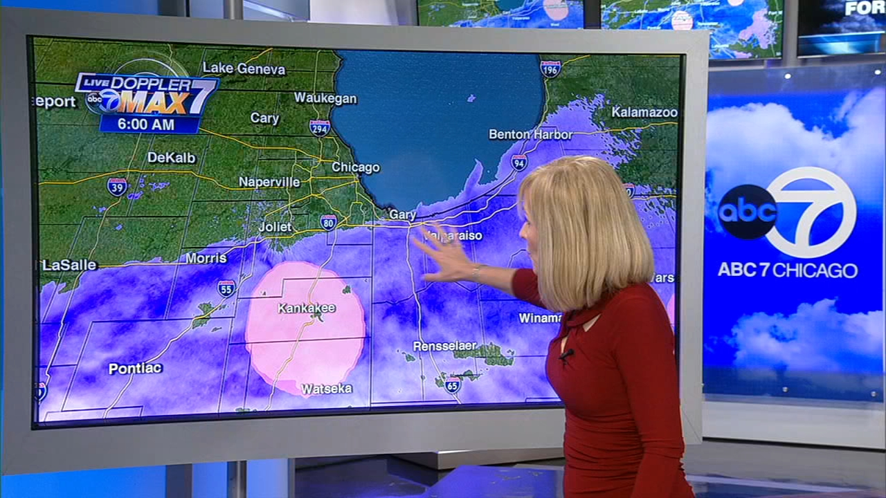 Tracy Butler tracks the snow moving across the Chicago area Thursday.