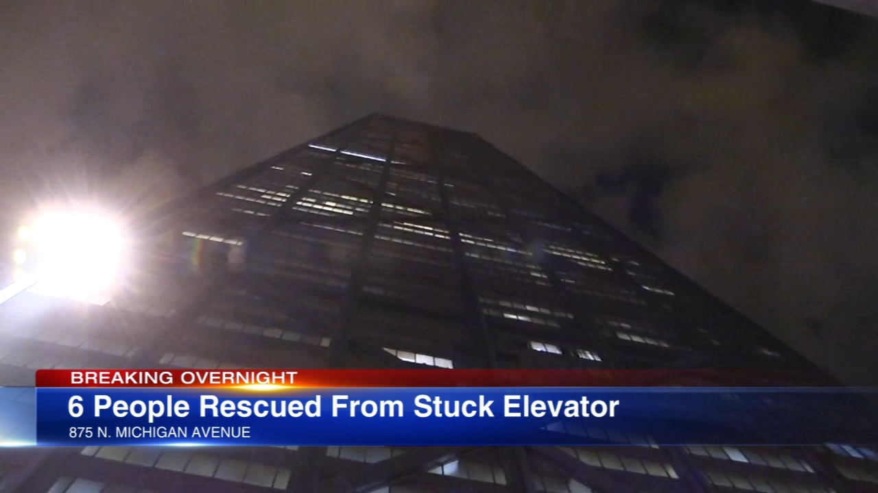 Six people were rescued after being trapped in an elevator at the building formerly known as the John Hancock Center.