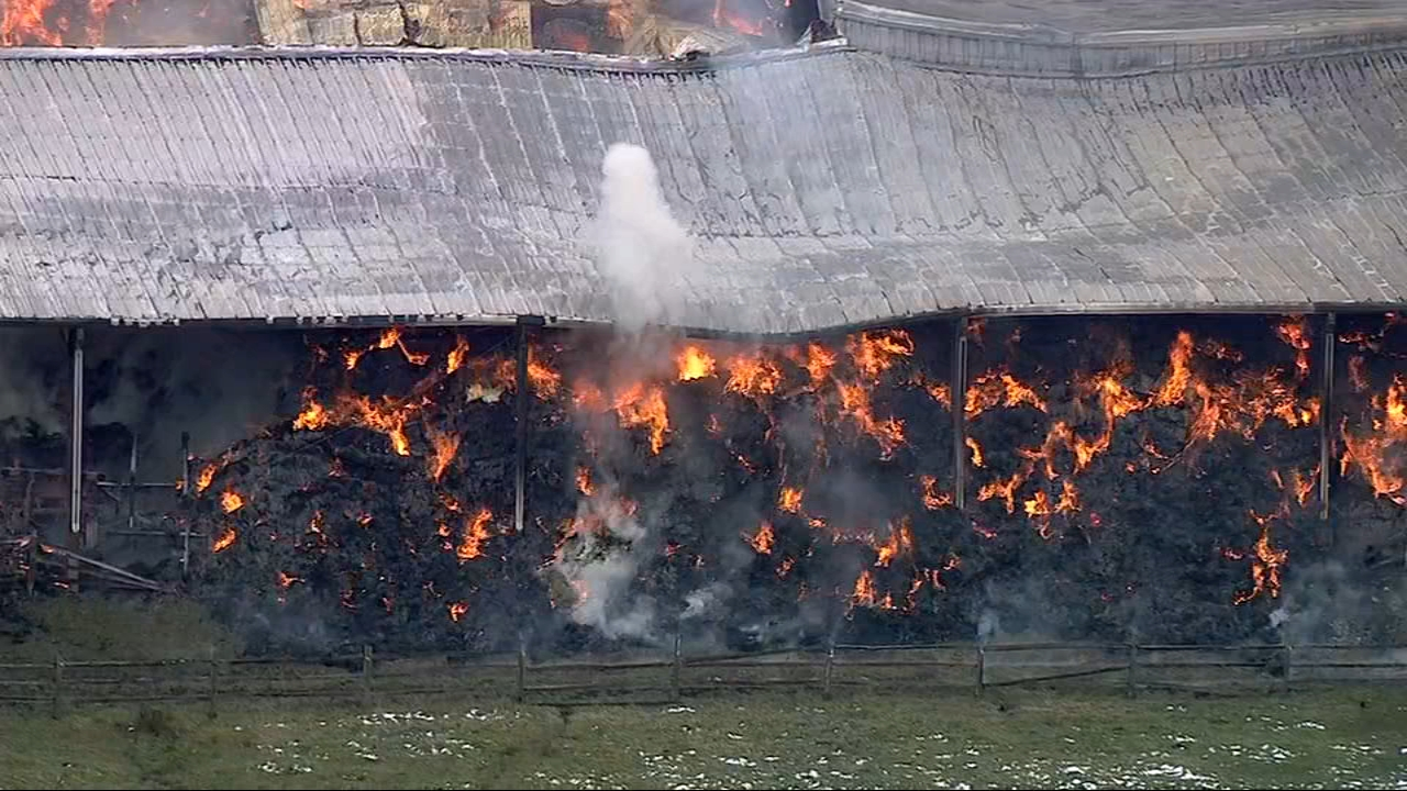 Firefighters respond to a fire inside a barn in Warrenville Monday afternoon.