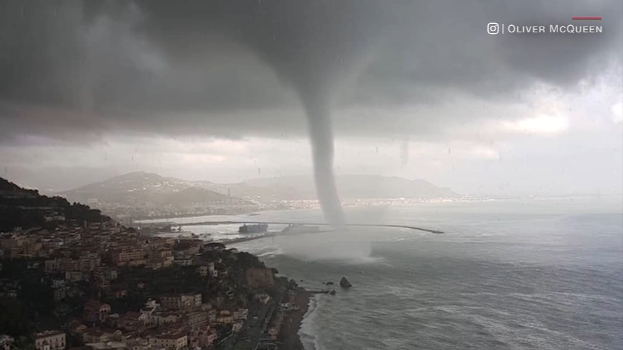 A rare and massive waterspout was captured on video swirling over the southeastern coast of Italy.