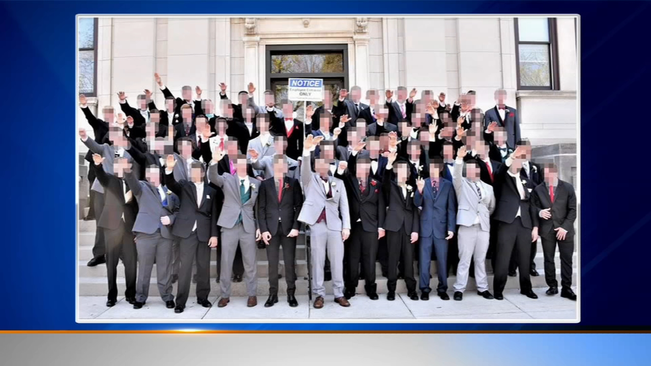 Officials with a Wisconsin school district say free-speech rights would make it difficult to discipline students who appeared in a photograph that showed several high school boys g