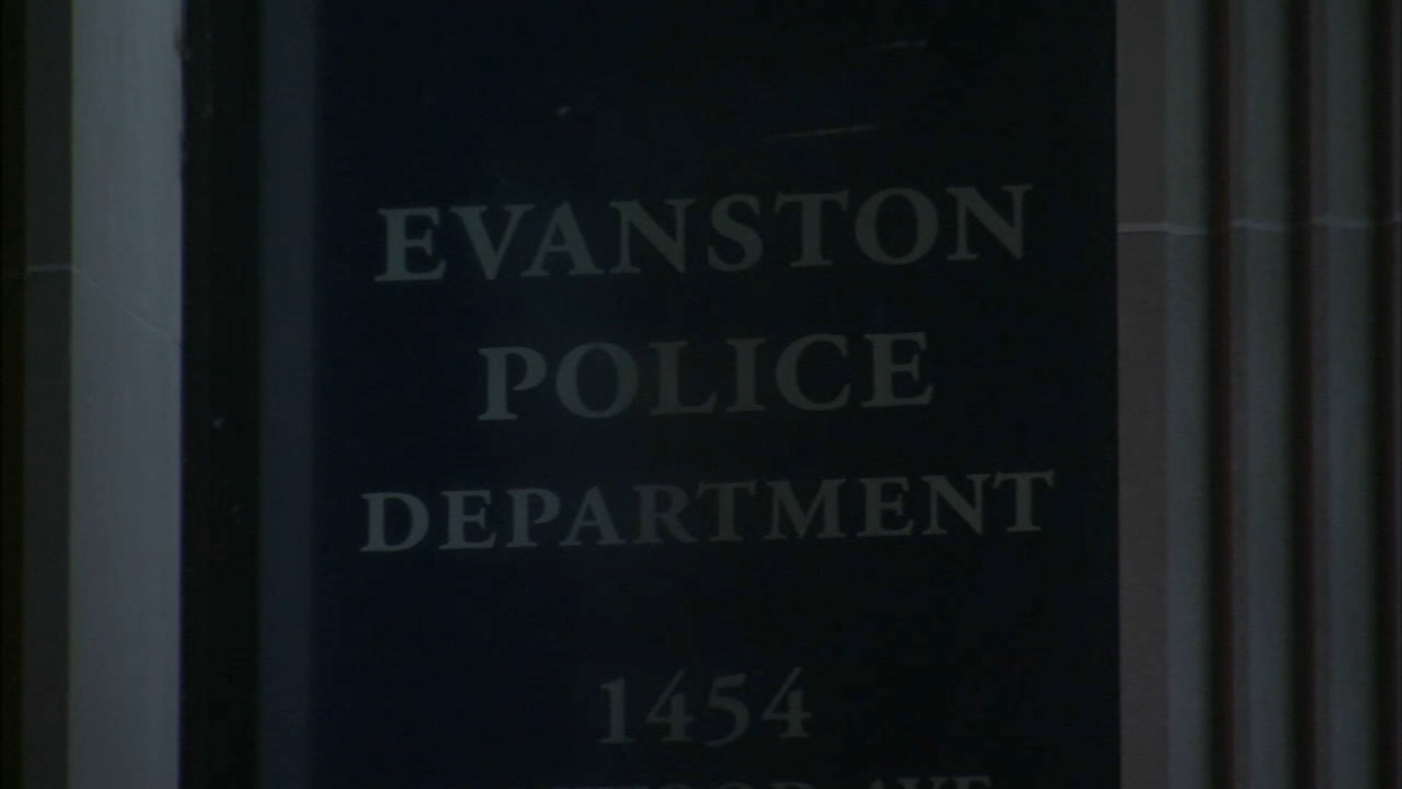 A group of men knocked down and robbed an elderly woman in her Evanston home on Tuesday, police said.