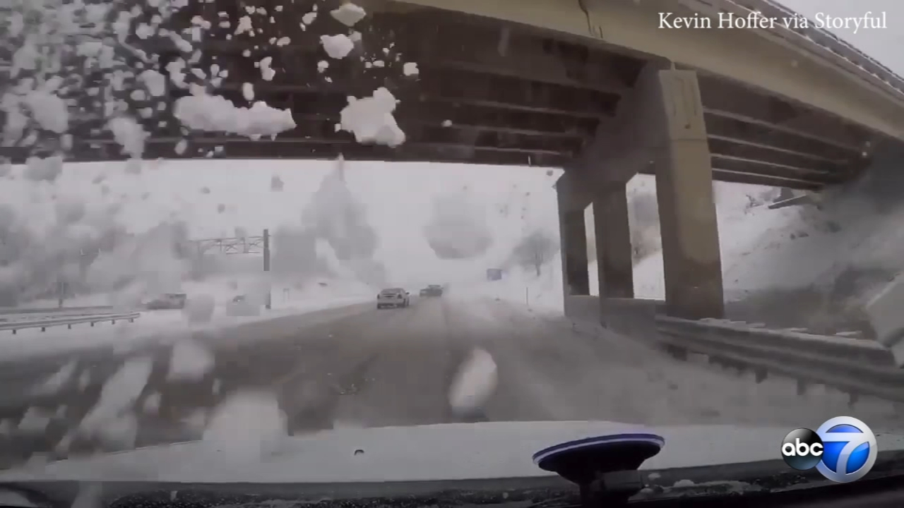 A freak accident was caught on video when a snow plow dumped snow on a highway, shattering a drivers windshield.
