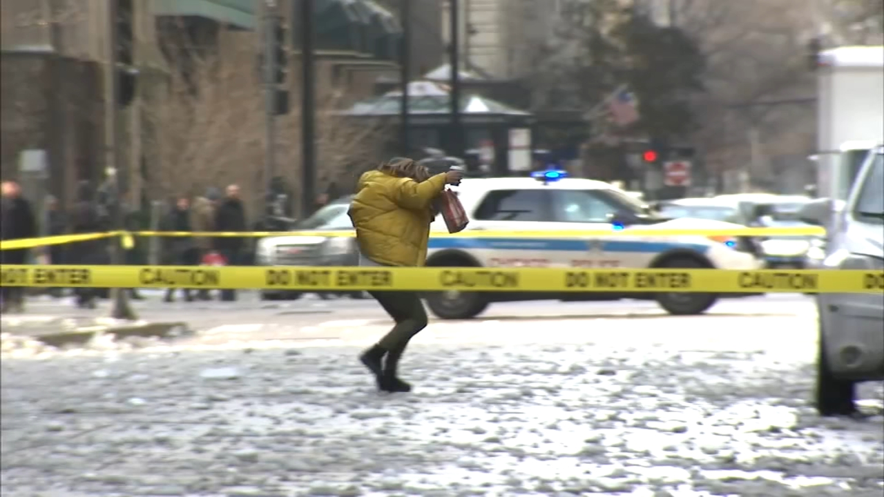 Several streets in downtown Chicago were temporarily closed Thursday to protect pedestrians and drivers from falling ice and snow.