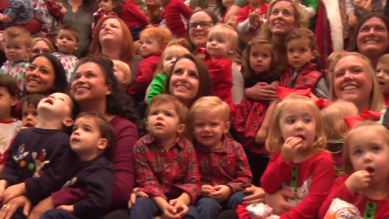 23 sets of twins piled into a giant group photo with Santa at the Woodfield Mall in Schaumburg on Thursday.