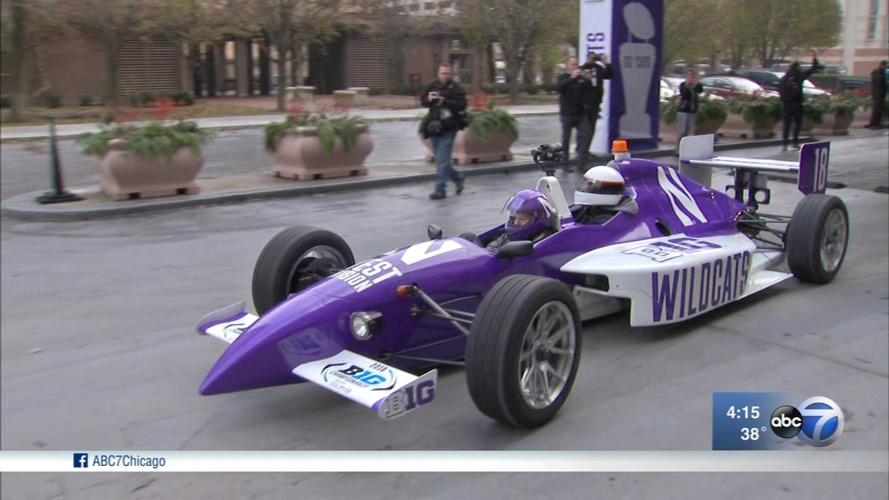 With an Indy car escort, the Northwestern Wildcats rolled into Indianapolis Friday ahead of their Big Ten Championship debut.