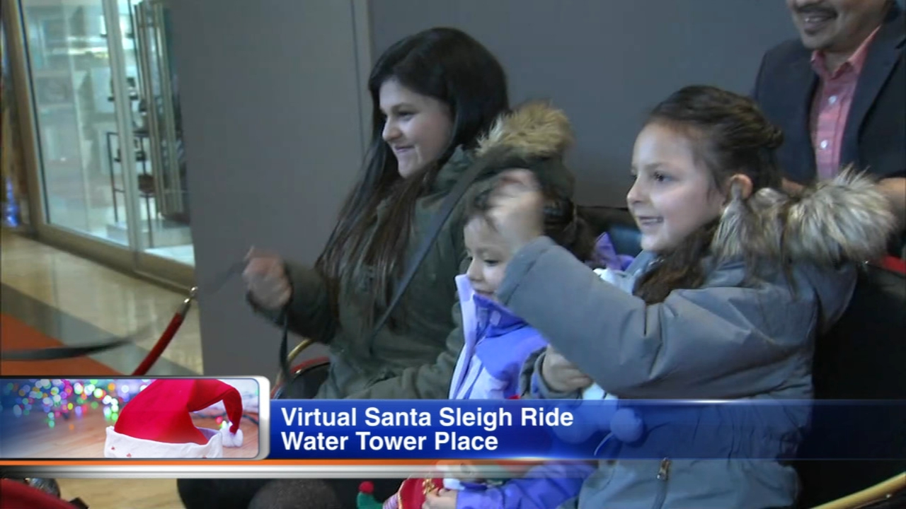 Take a ride to the North Pole on Santas magic sleigh. A new virtual reality ride flies you through crowded streets and highways with the help of Santas reindeer.