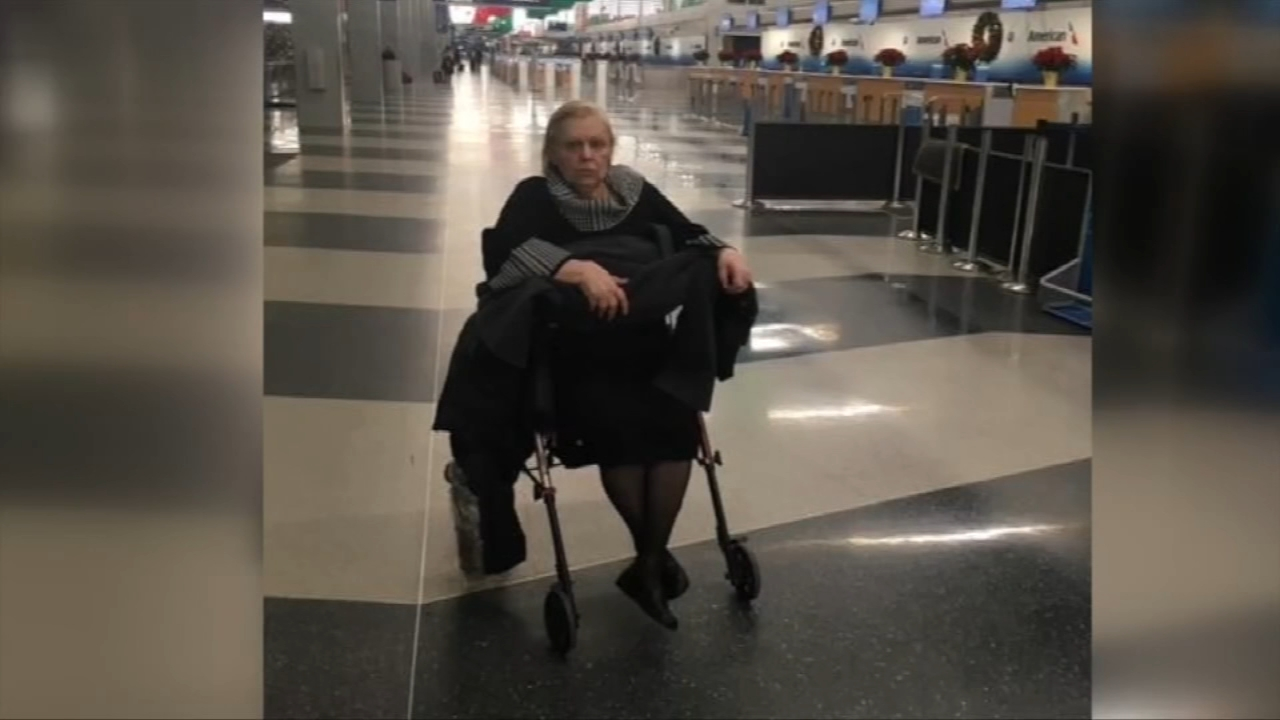 American Airlines says an elderly woman who uses a wheelchair and claimed she was abandoned at OHare Airport on Saturday after her flight was canceled was not actually left alone