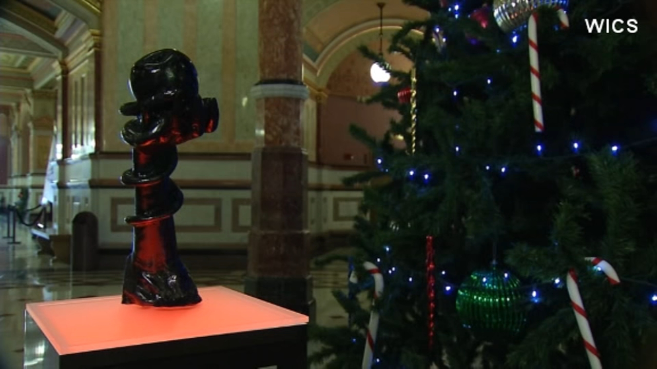 A Satanic Temple statue now stands alongside other religious displays, including a nativity scene and a menorah, in the Illinois state capitol building.