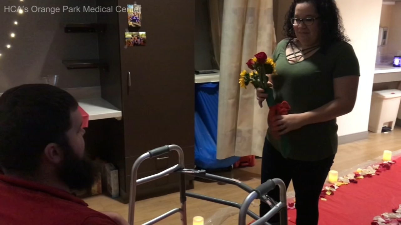 A man recovering from paralysis gave his girlfriend the surprise of her life when he stood up from his wheelchair to ask for her hand in marriage.