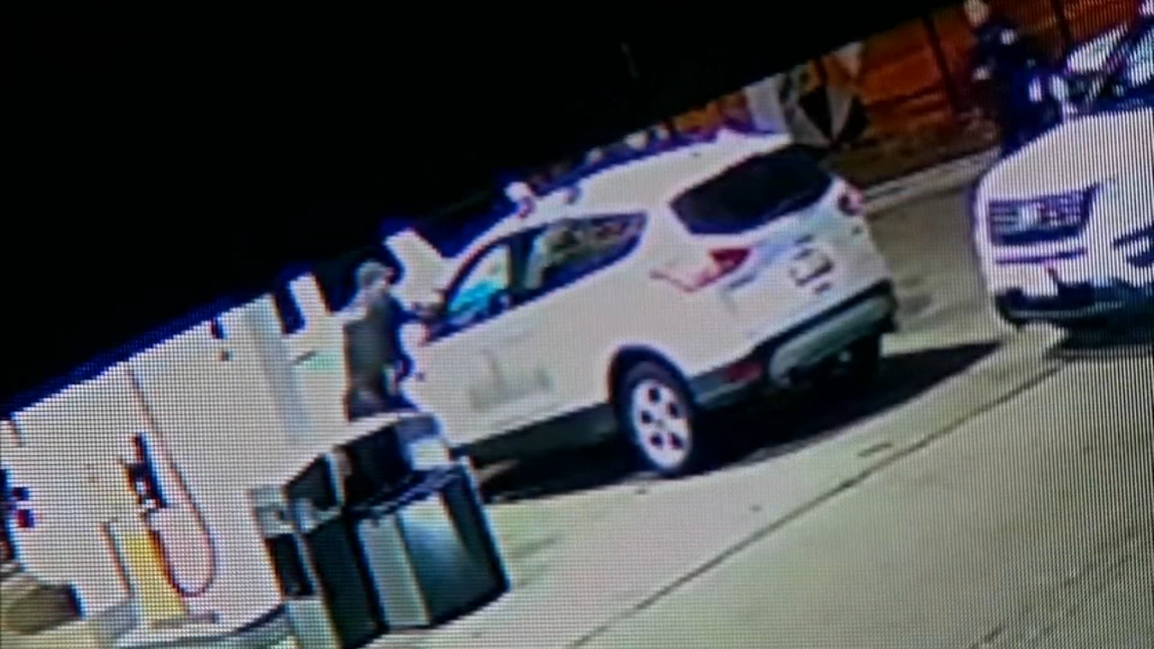 Surveillance video from a West Side gas station shows a police-involved shooting that left a suspect wounded in the wrist.