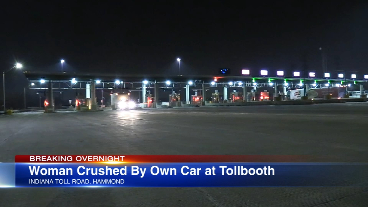 A woman is fighting for her life after being pinned against an Indiana toll booth by her own car Saturday night.