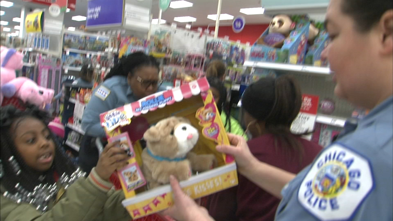 Police officers were on hand to help with the festivities at the annual Shop with a Cop event hosted by Israel Idonije.